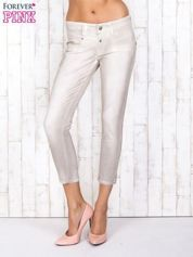 Beżowe mieniące się spodnie z brokatem i przetarciami