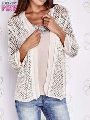 Beżowy ażurowy sweter z tiulowym wykończeniem rękawów