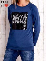 Ciemnoniebieska bluza ze zmieniającą się naszywką z cekinów
