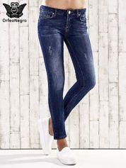 Butik Ciemnoniebieskie spodnie rurki z dżetami