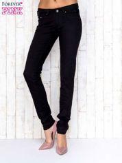 Czarne przecierane spodnie jeansowe regular jeans