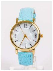 Damski zegarek z dużą i wyraźną perłową tarczą