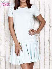 Miętowa sukienka dresowa z kokardami z tyłu