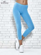 Turkusowe legginsy sportowe z aplikacją z dżetów na nogawkach