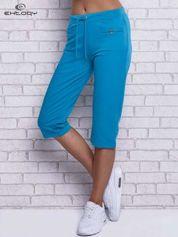 Turkusowe spodnie dresowe capri z wszytymi kieszonkami