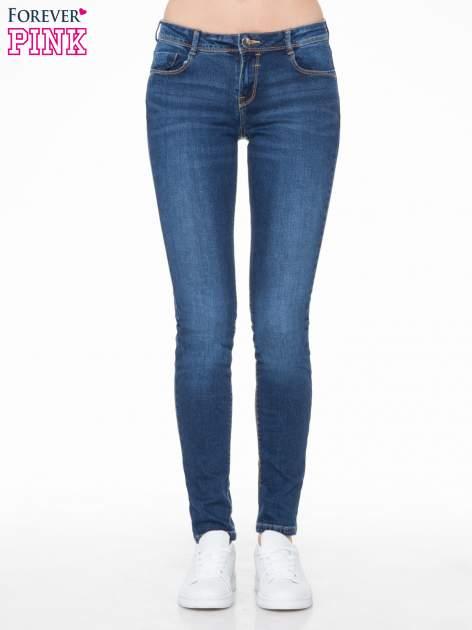 Ciemnoniebieskie spodnie typu skinny jeans z cieniowaniem