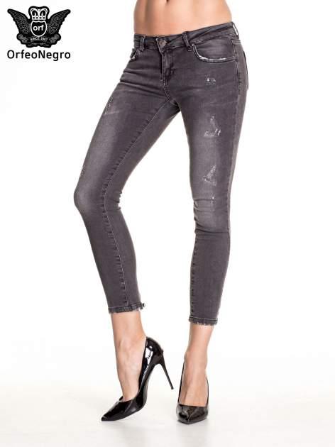 Czarne dopasowane spodnie skinny jeans z przetarciami i zamkami na dole