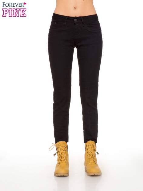Czarne klasyczne spodnie jeansowe rurki