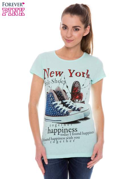 Jasnozielony t-shirt z nadrukiem trampek