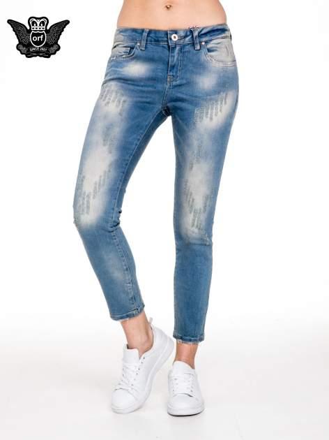 Spodnie jeansowe rurki z pionowymi przetarciami