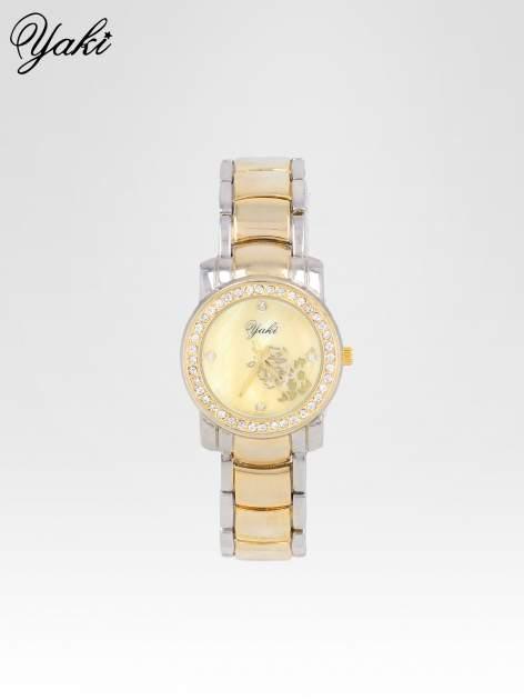 Złoty zegarek damski na bransolecie z subtelnym zdobieniem
