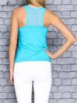 Niebieski top sportowy z siateczką i nadrukiem floral print