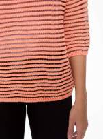 Pomarańczowy półtransparentny sweter w prążki