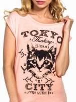 Pomarańczowy t-shirt z kotem i napisem TOKYO CITY