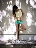 Zielone materiałowe szorty z podwijaną nogawką