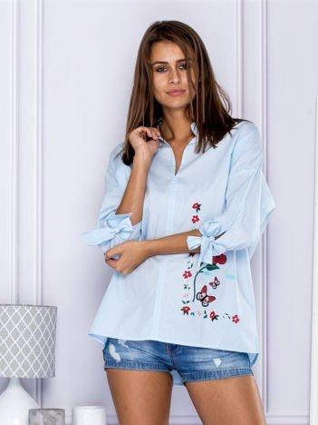 Bawełniana koszula oversize z kwiatową aplikacją niebieska