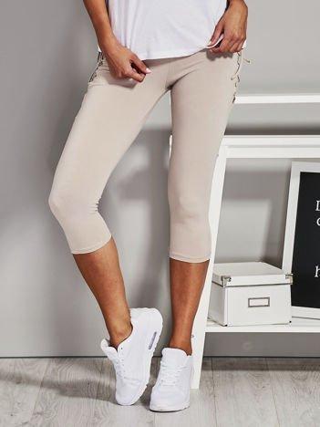 Beżowe krótkie legginsy lace up