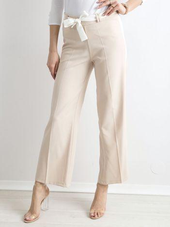 Beżowe szerokie spodnie z lampasami