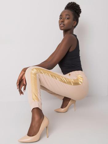Beżowo-złote spodnie dresowe z lampasem Ewelyn