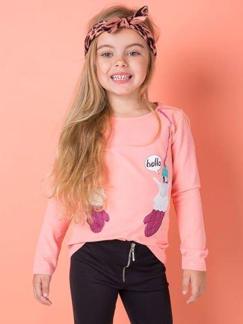 Bluzka dla dziewczynki z zimowym nadrukiem brzoskwiniowa
