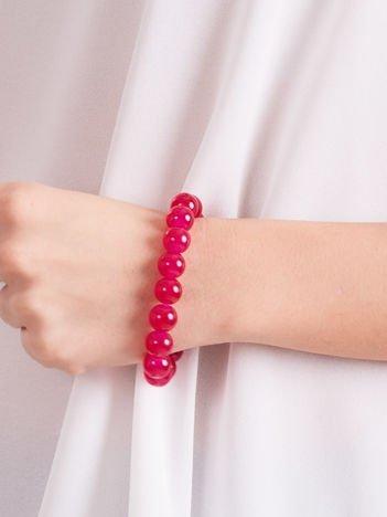 Bransoletka damska na gumce z różowymi perełkami