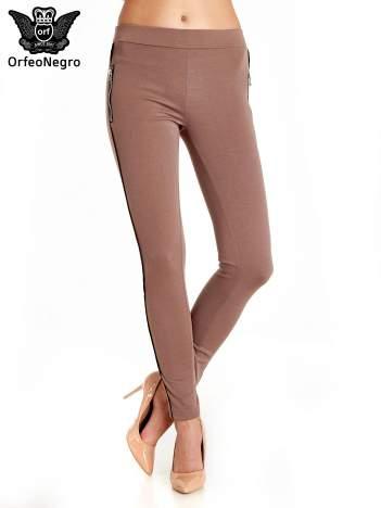 Brązowe spodnie materiałowe tregginsy ze skórzanym lampasem i zamkami