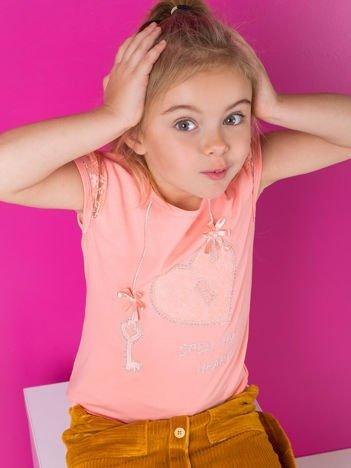 Brzoskwiniowa bluzka dla dziewczynki z dżetami