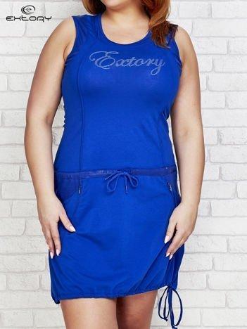 Ciemnoniebieska sukienka sportowa z kieszeniami na suwak