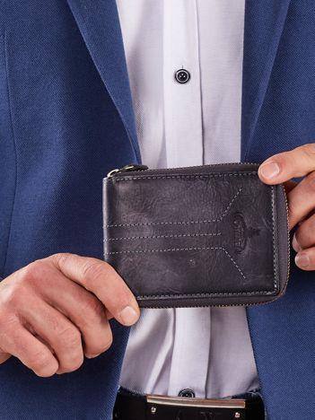 Ciemnoniebieski męski portfel na suwak