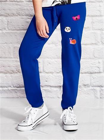 Ciemnoniebieskie spodnie dresowe dla dziewczynki ze zwierzątkami