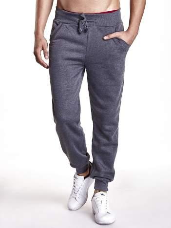 Ciemnoszare dresowe spodnie z trokami w pasie i kieszeniami