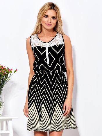 8d76fa4fa3 Czarna sukienka w kontrastowe zygzaki