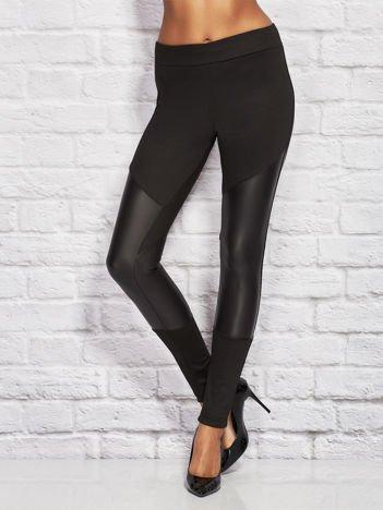 Czarne legginsy ze skórzanymi wstawkami na nogawkach