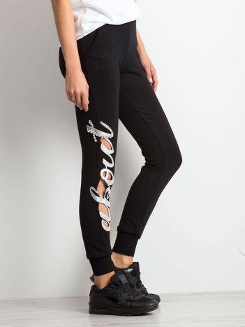 Czarne spodnie dresowe Winning