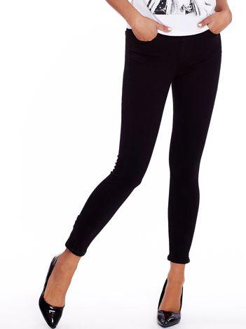 Czarne spodnie high waist z suwakiem i kokardkami