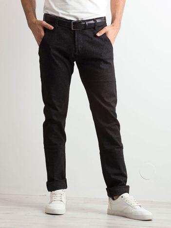 Czarne spodnie jeansowe męskie