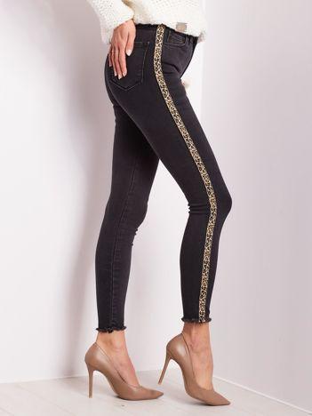 Czarne spodnie skinny fit z lampasami
