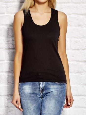 Czarny top damski z rozcięciami na plecach