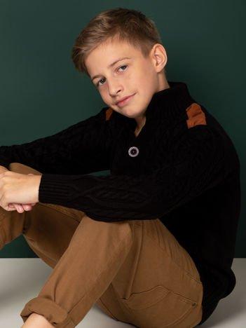 Czarny zapinany sweter dla chłopca w warkocze