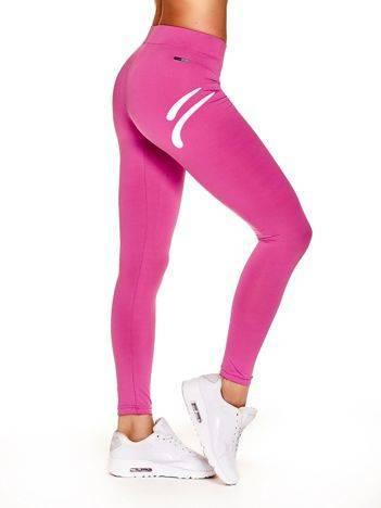 Długie cienkie legginsy na siłownię ze znaczkiem sportowym ciemnoróżowe