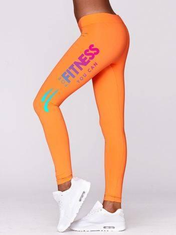 Długie legginsy do fitnessu z tęczowym nadrukiem fluo pomarańczowe