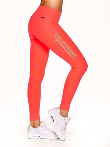 Długie legginsy na siłownię z napisem CALIFORNIA fluokoralowe