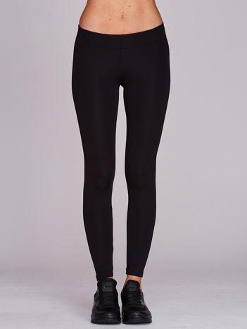 Długie lekko ocieplane legginsy sportowe czarne
