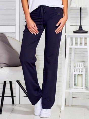 Grafitowe spodnie dresowe z przeszyciami