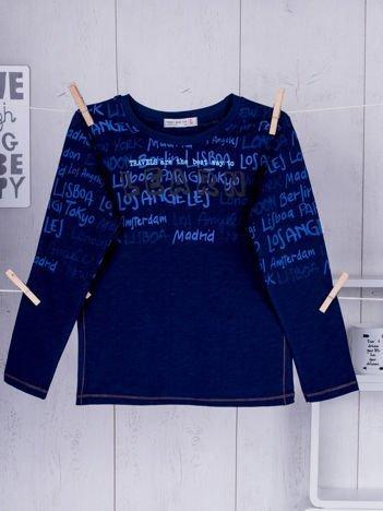 Granatowa bluzka dziecięca z tekstowym nadrukiem