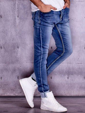 Granatowe spodnie jeansowe męskie regular