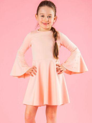 Jasnoróżowa rozkloszowana sukienka dziewczęca