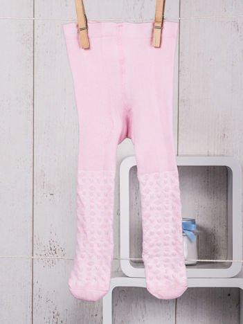 Jasnoróżowe bawełniane rajstopki niemowlęce ze zdobieniami dla dziewczynki