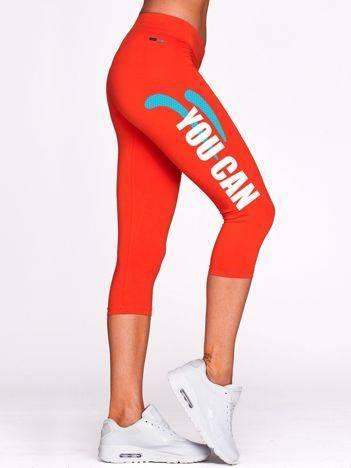Krótkie kryjące legginsy sportowe z nadrukiem ciemnopomarańczowe