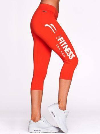 Krótkie legginsy fitness z jasnym nadrukiem ciemnopomarańczowe